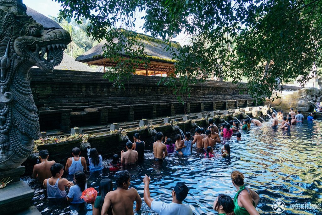Believers going through the cleansing ritual at the tirta Empul water temple in Bali, Indonesia