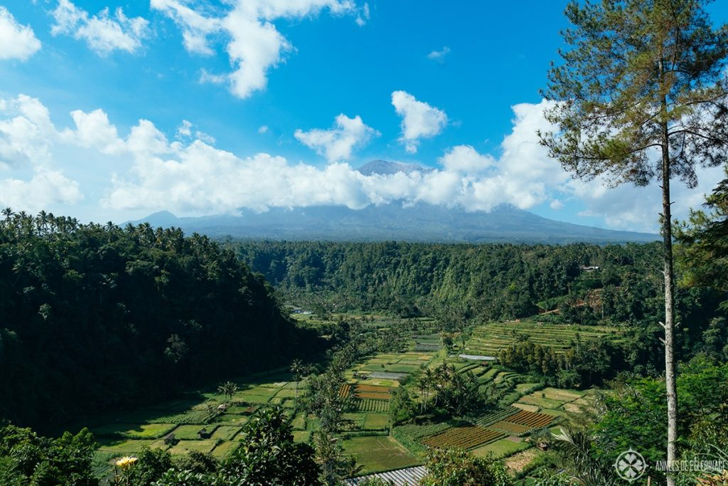 Mount Ayung volcano in East Bali with beautiful rice terraces in front of it