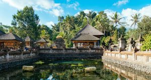 The main pond of the Tirta Empul water temple where arre spring is said to have its source. It's one of the biggest and most important Hindu temples and one of the things to do in Bali, Indonesia