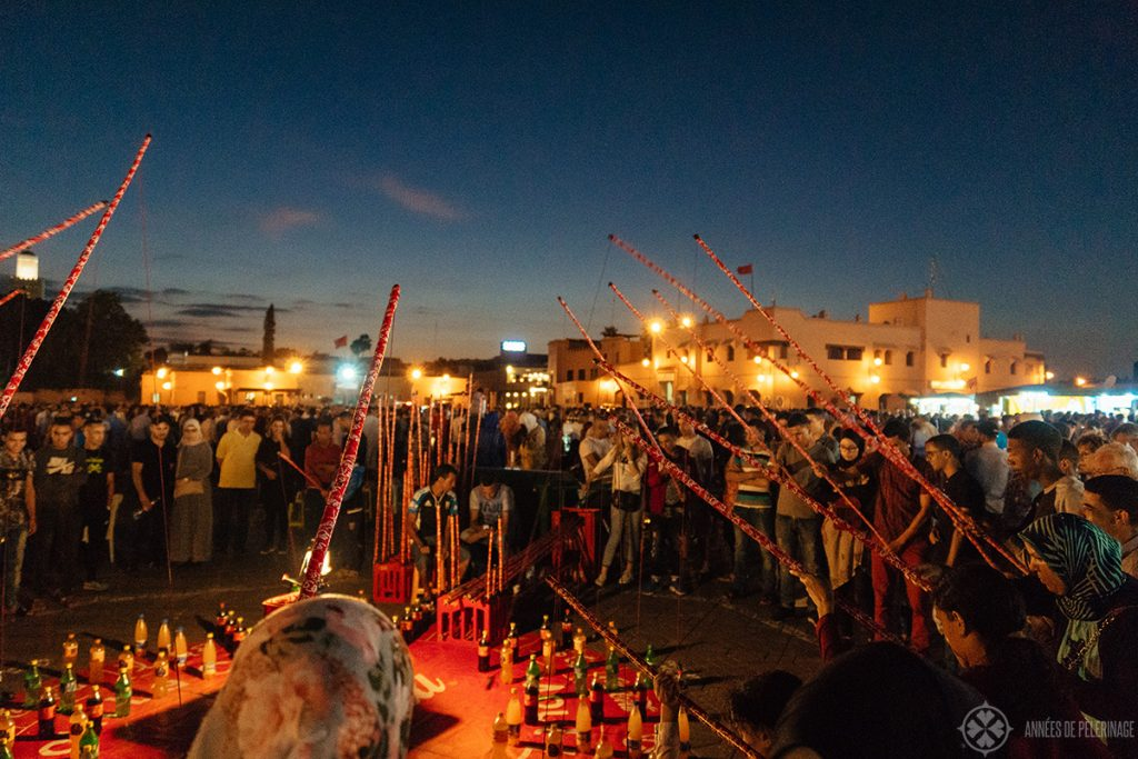 Locals playing a game of skill on the Jemaa El-Fnaa in Marrakech, Morocco