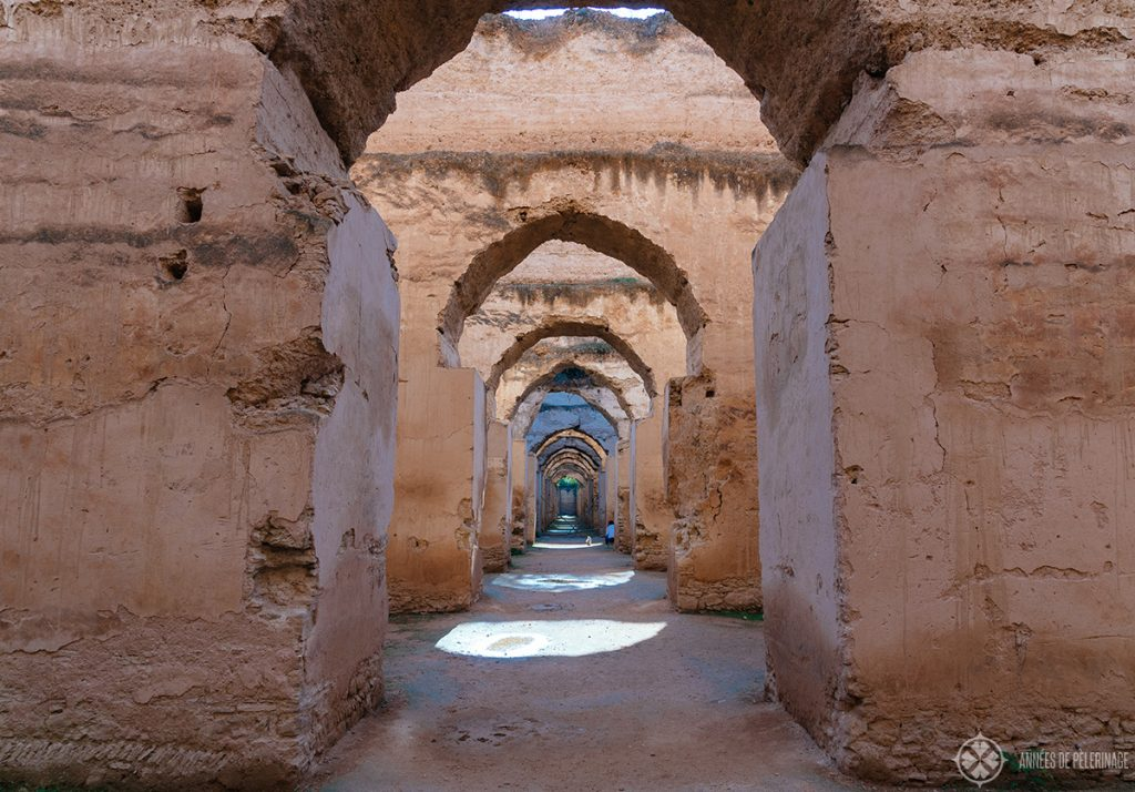 View along the endless corridors of the royal stables of Meknes, Morocco
