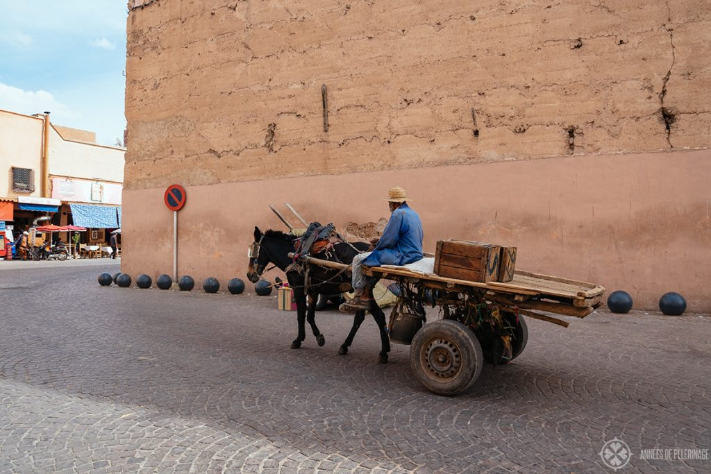 A lone carriage driving through the Medina of Marrakech, Morocco. The traffic can be a big problem in this city, but the locals don't mind.