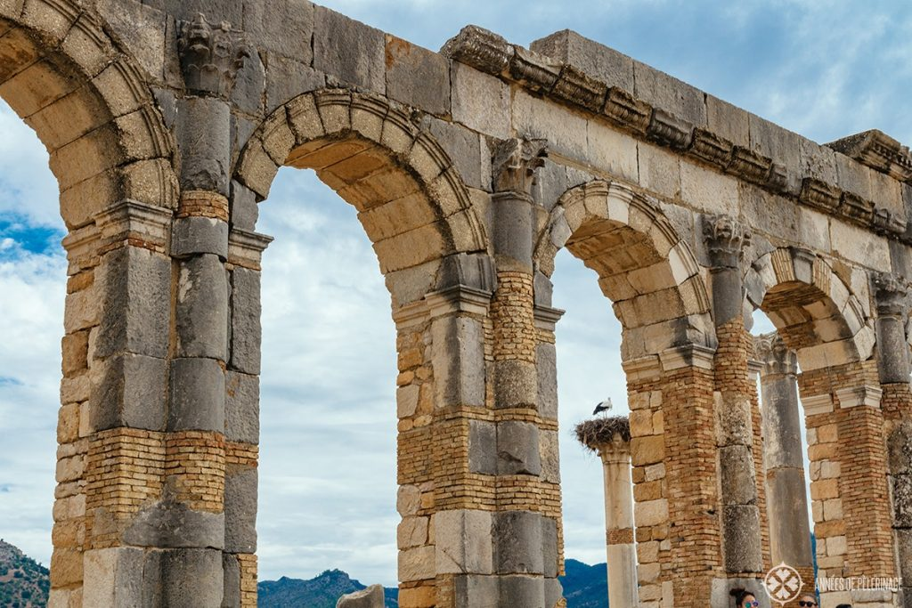 The remains of the main aqueduct of Volubilis - the best day trip from Meknes, Morocco