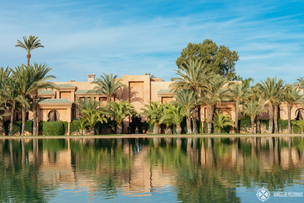 Villas along the grand basin of the Amanjena luxury hotel in Marrakech, Morocco