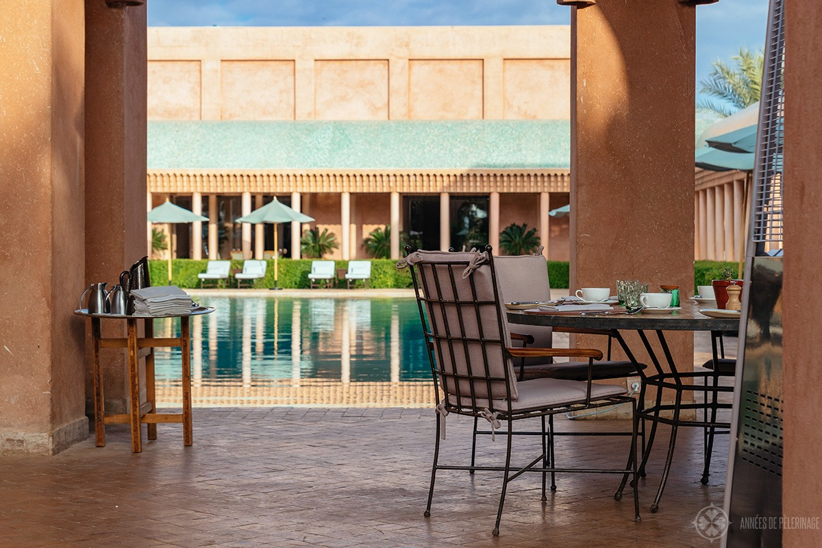 The breakfast restaurant with a view of the pool at Amanjena luxury hotel in Marrakech, Morocco