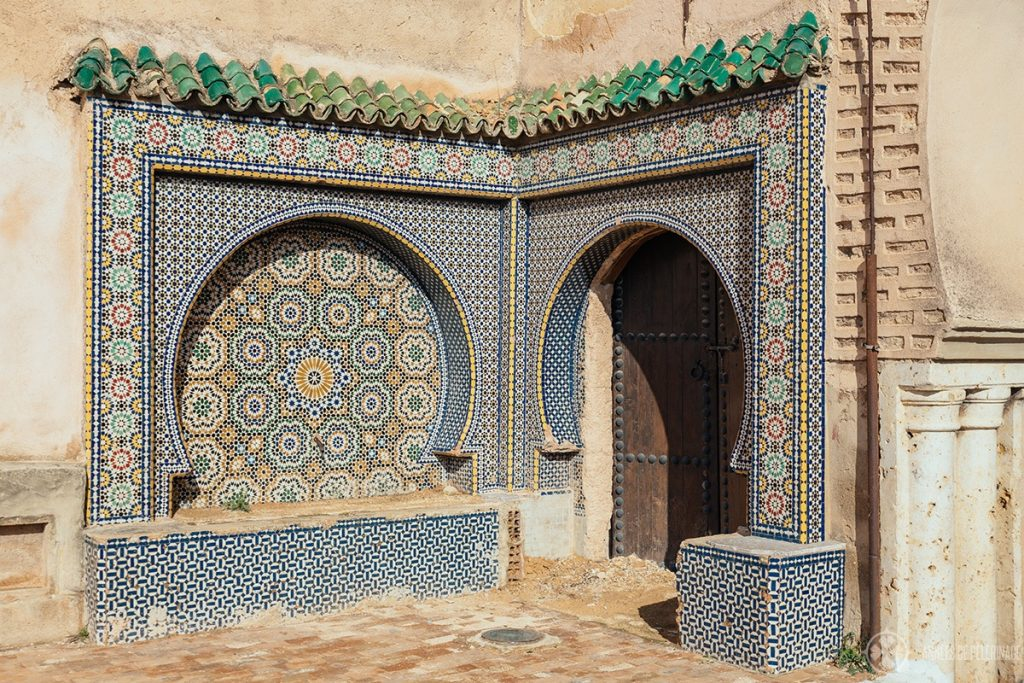 An unknown door with a fountain in Meknes, Morocco
