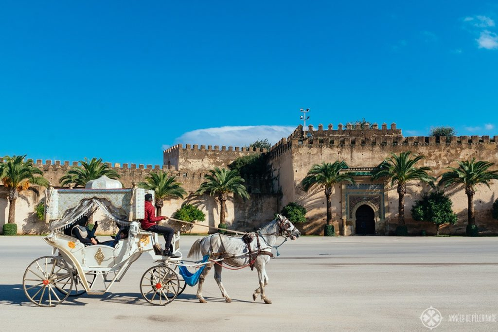 A fairy tale horse carriage in front of the royal palace of Meknes, Morocco