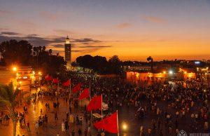 Jemaa El-Fnaa with the Koutoupia Mosque in the background in Marrekesh Morocco