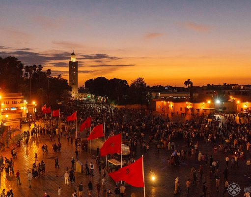 Jemaa El-Fnaa with the Koutoupia Mosque in the background in Marrekesh Morocco