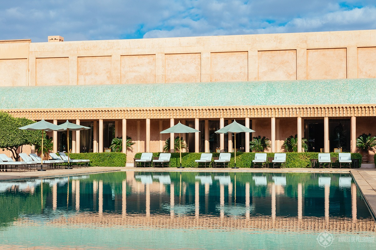 Sun loungers at the pool of the Amanjena luxury hotel in Marrakesh, Morocco