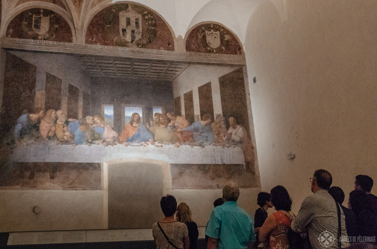Tourists in front of the Last Supper - not the barrier in front of it