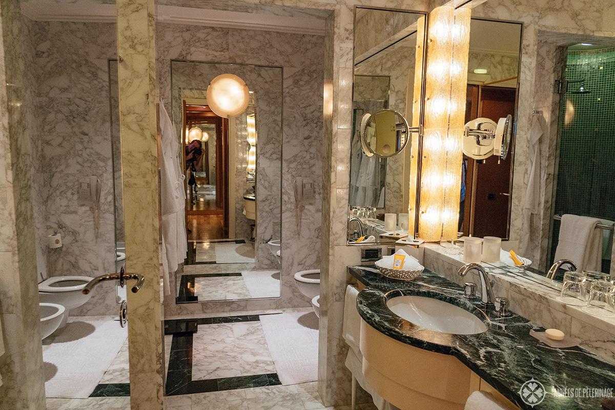 the white and green marble bathroom of the Four Seasons Hotel Milano, Italy