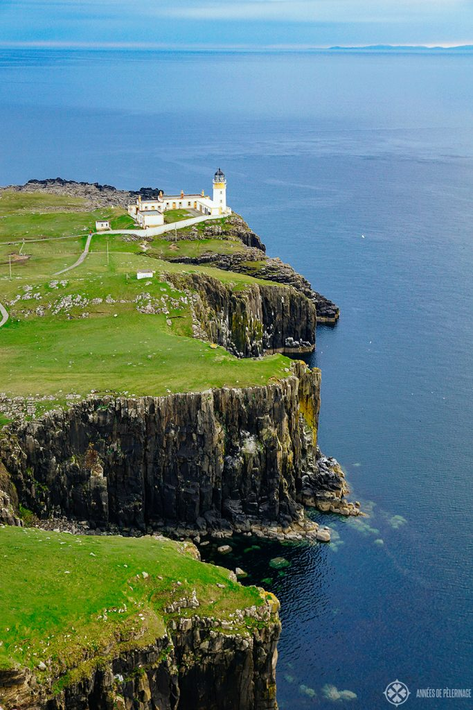 Neist Point lighouse sitting on high cliffs on the Isle of Skye in Scotland