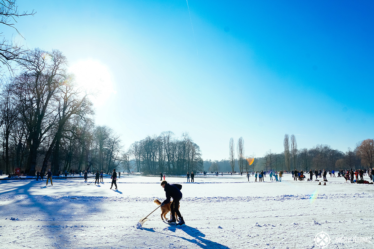 Locals skating on Kleinhesseloher Lake in Englische Garten in winter