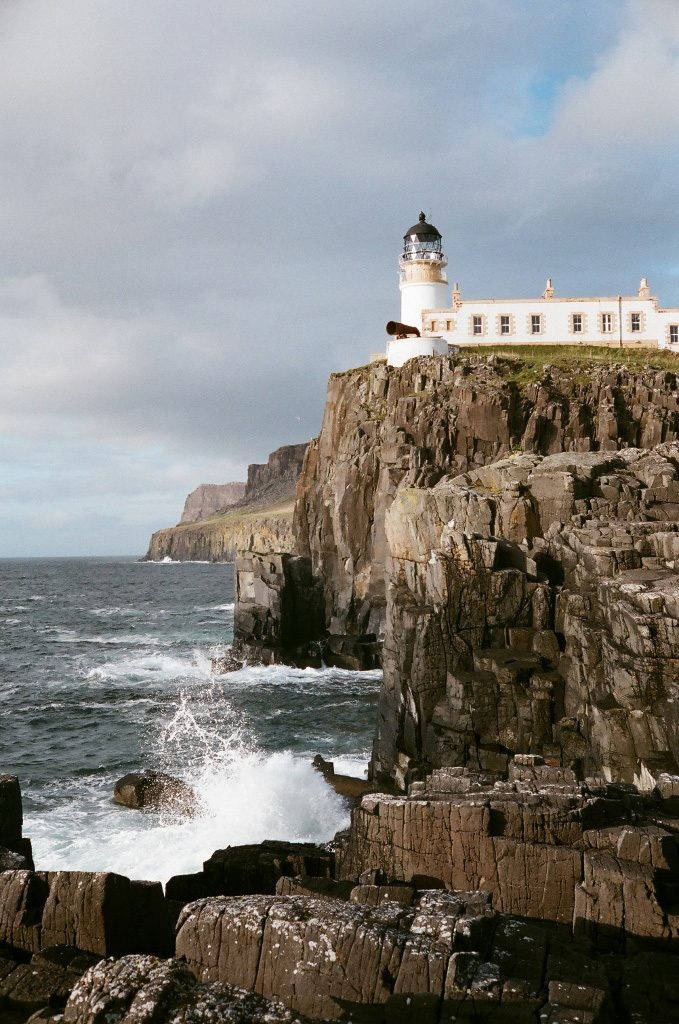Lighthouse with basalt cliffs