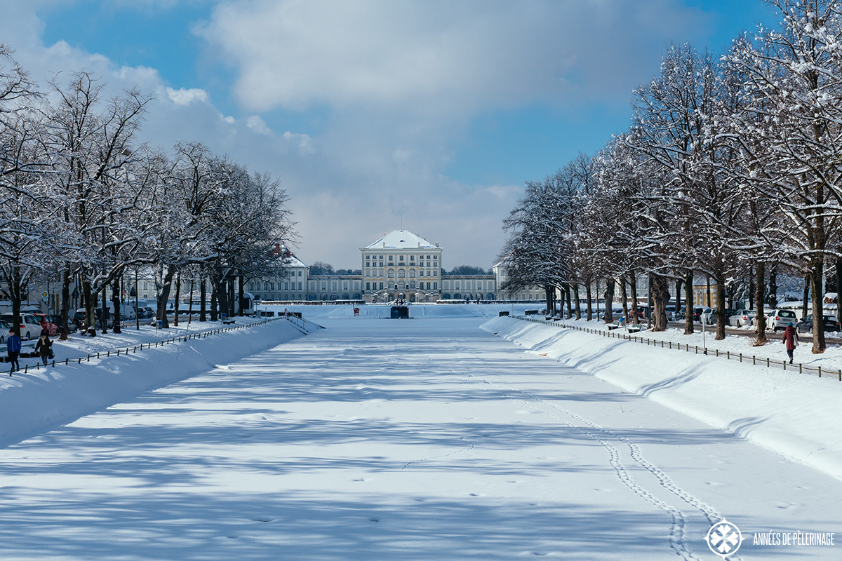 Nymphenburg castle in winter with the artifical water channel in front of it