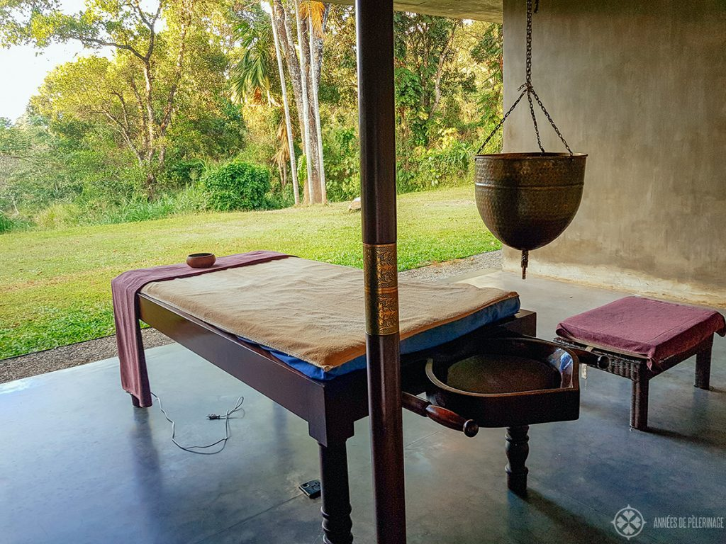 The setting for a traditional Shirodhara massage oil drip massage