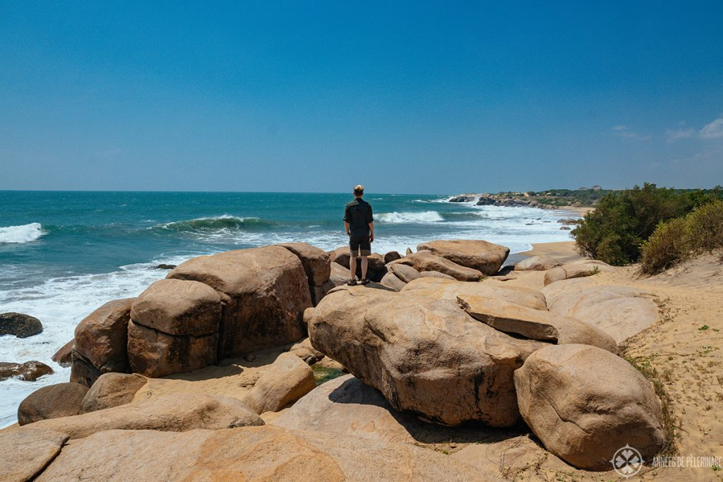Me at the beach of Yala national Park with the Wild Coast Tended Lodge in the far background Sri Lanka
