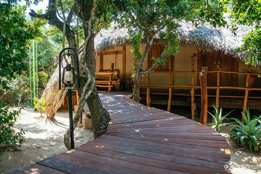 Entrance to a villa at Chena Huts Safari Lodge by uga escapes in Yala National Park Sri lanka
