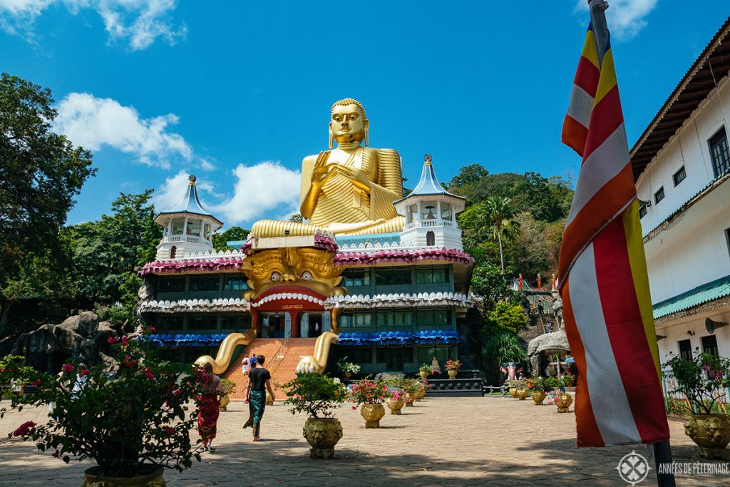 The golden Buddha at the foot of the hill leading towards the Dambulla Cave temple