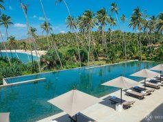 View of the main pool and the beach beyond at Amanwella Sri Lanka
