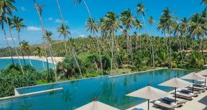 View of the main pool and the beach beyond at Amanwella Sri Lanka