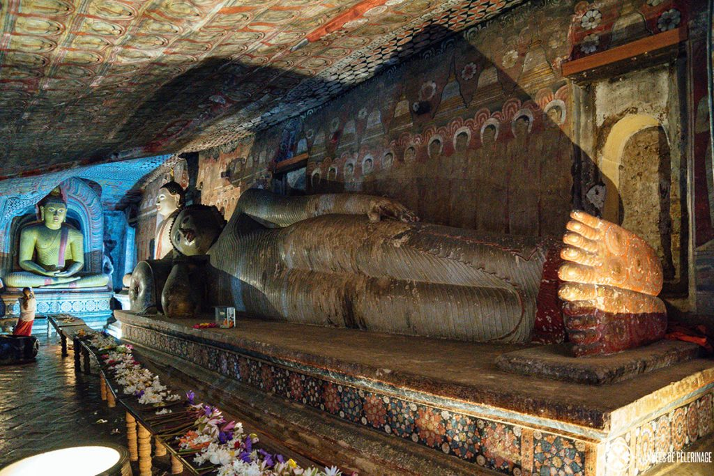 A sleeping Buddha statue inside the Dambulla Cave Temple - a unique UNESCO World Heritage site you have to put on your Sri Lanka itinerary