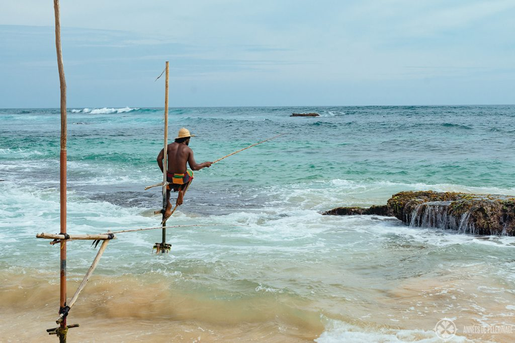 One of the famous stilt fishers of Sri Lanka as seen near Mirisa in Sri Lanka