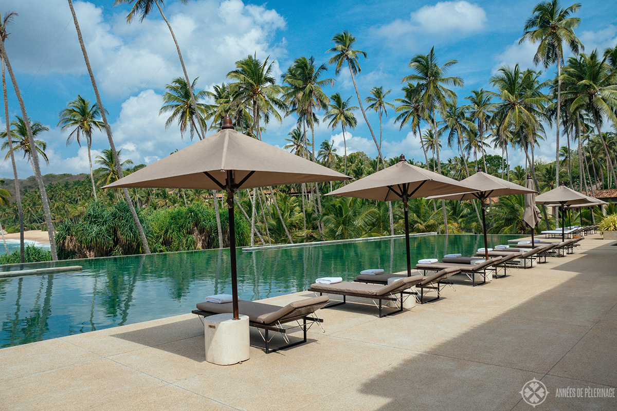 sun loungers at the main pool of the amanwella luxury hotel in sri lanka