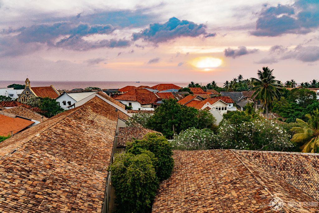 Sunset above the roofs of Galle as seen from the amangalla luxury hotel