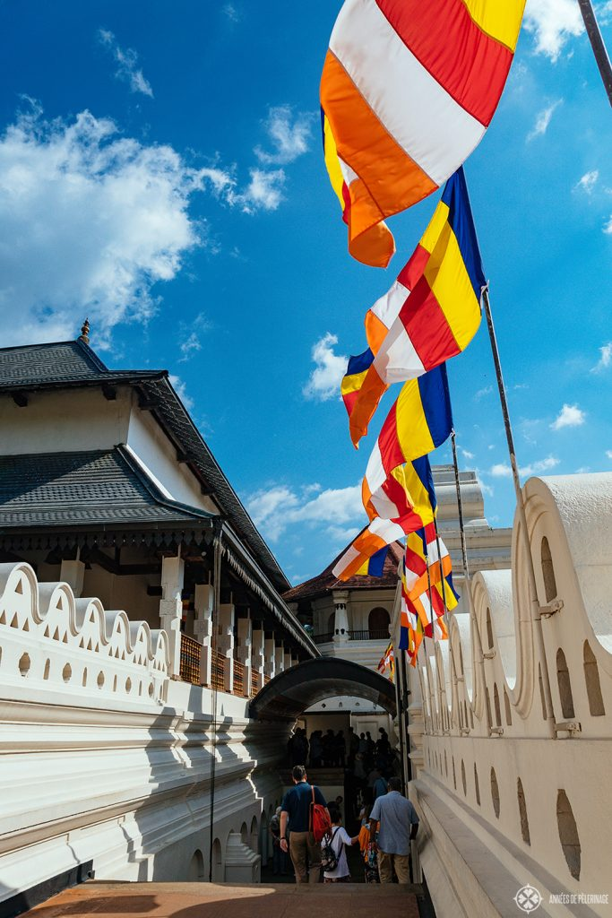 Buddhist banners above the Temple of the Tooth in Kandy, Sri Lanka