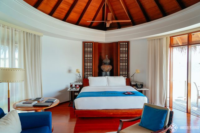 A bedroom of an overwater bungalow at the Constance Halaveli luxury resort, Maldives