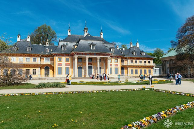 Tourists in front of the Bergpalais with its Chinoiserie murals in Pillnitz castle, Germany