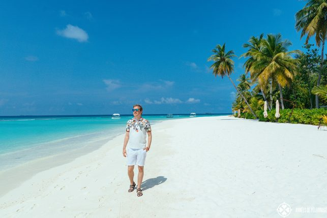 Me walking and reviewing the Constance Halaveli luxury resort on the Maldives