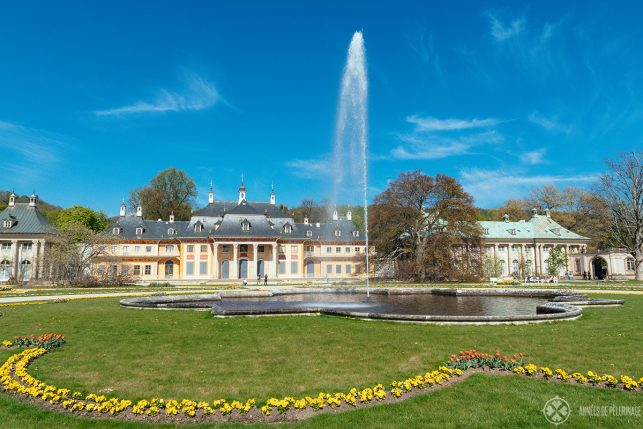 The Bergpalais with the grand fountain of Pillnitz castle in the foreground. Such a beautiful day trip from Dresden, Germany