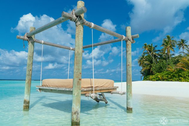 A swinging bed in the water at the far end of the island that is home to the Constance Halaveli luxury resort in the Maldives