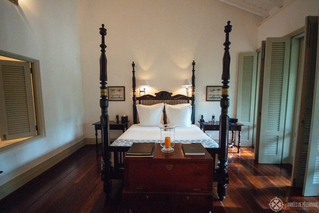 A beautiful four poster bed inside the Verandah Chamber of the Amangalla luxury hotel