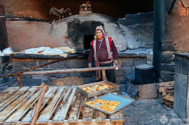 A local preparing fresh empanadas - just one of many street food options in Pisac market