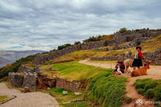 A group of local women posing for pictures in Sacsayhuaman
