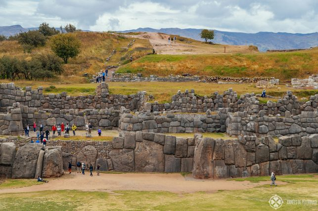 A group of tourists exploring Sacsayhuaman in Cusco Peru