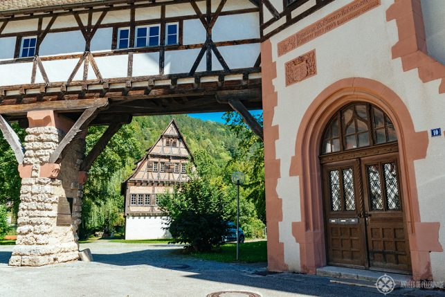 View of the bathhouse of the monks through an arch of the Blaubeuren Abbey