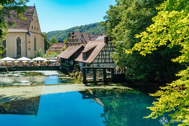 View of the Blautopf and the Blaubeuren Abbey in Germany