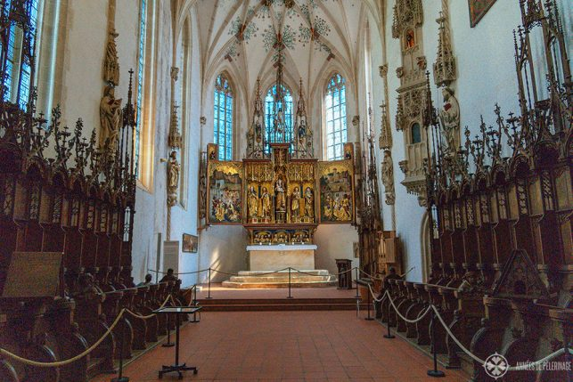 The medieval high altar and choir stalls inside the church of Blaubeuren Abbey
