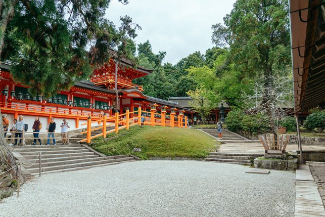 The entrance to the main hall of Kasuga Taisha with a rock garden in the foreground