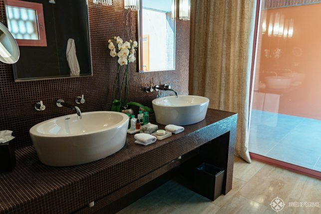 The bathroom with his and her sinks inside the Oliveto suites