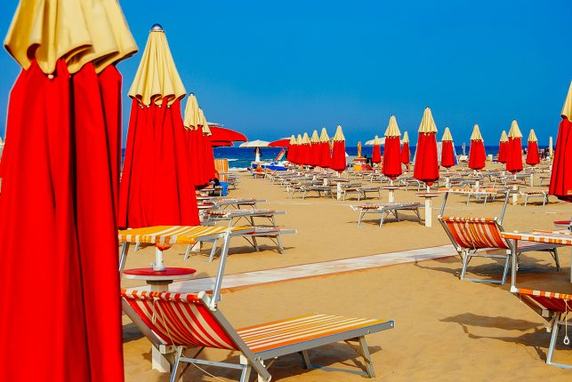 Empty sun loungers in Rimini, Italy
