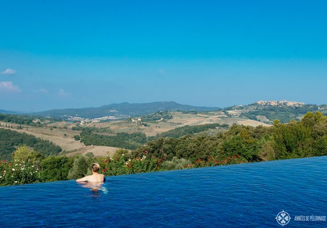 Me enjoying the fantastic view of Tuscany from the pool at Belmond Castello di Casole