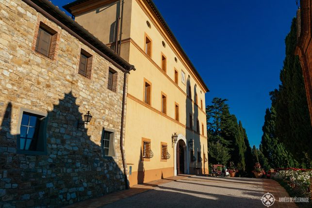 The historic main building of the Belmond Castello di Casole luxury hotel in the heart of TUscany, Italy