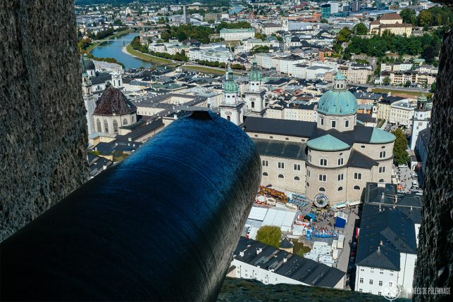 View of Salzburg's old town through the embrasures of the wall around castle Hohensalzburg