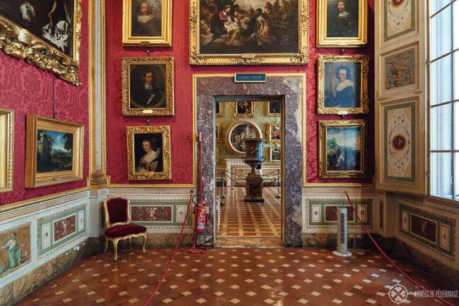 The art gallery inside the Pitti Palace - the walls are covered floor to ceiling with paintings like in a historic setting